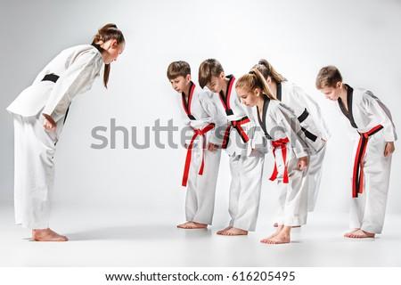 The studio shot of group of kids training karate martial arts #616205495