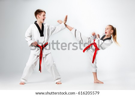 The studio shot of group of kids training karate martial arts #616205579