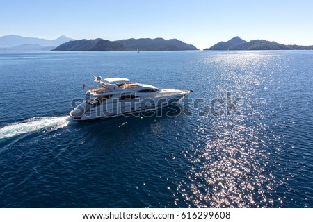 Luxury Yacht Aerial View Royalty-Free Stock Photo #616299608