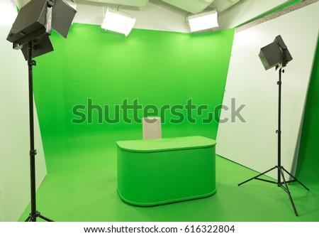 Modern TV Studio Green Screen chroma key background with camera and Light Equipment