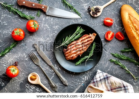 pork steak in home food concept on gray background top view #616412759