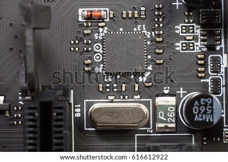 Computer motherboard with a view of parts and components #616612922