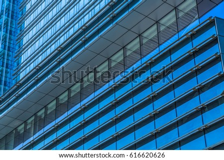Urban abstract - windowed corner of office building  #616620626