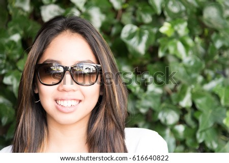 happy young woman portrait close up smiling with sunglasses #616640822