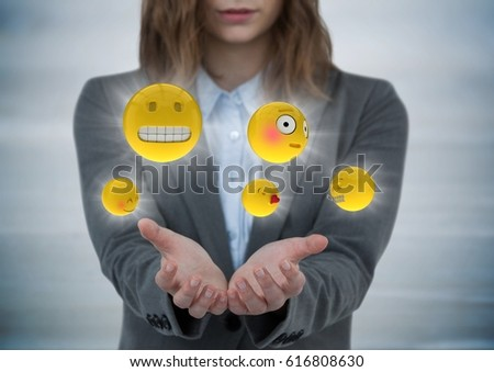 Digital composite of Business woman with hands out and emojis with flares against grey wood panel #616808630