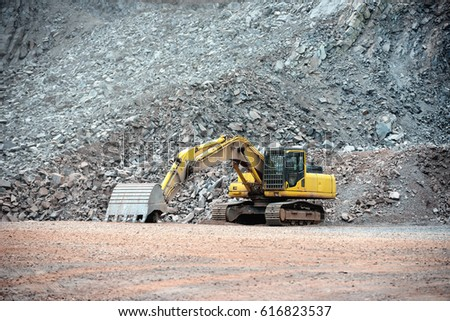 view in a quarry mine with excavator machine. porphyry rock. #616823537
