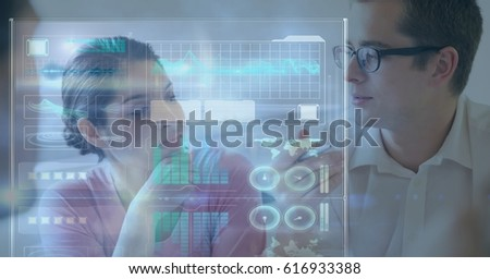 Digital composite of Digitally generated image of icons and graphs with business people in background #616933388