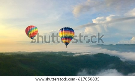 hot balloon fly over the cloud during sunrise at bagunan tropical gunung kidul yogjakarta #617050835