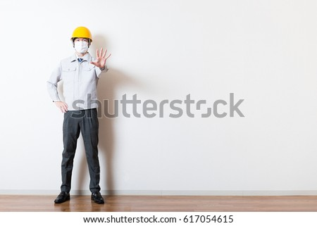 Men standing wearing work clothes with a white background #617054615