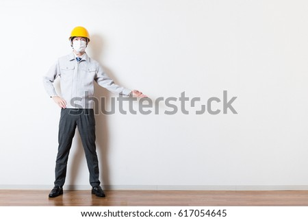 Men standing wearing work clothes with a white background #617054645
