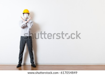 Men standing wearing work clothes with a white background #617054849