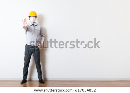 Men standing wearing work clothes with a white background #617054852
