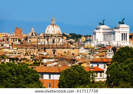 Rome, Italy. Aerial view of historical center of Rome, Italy with National Monument to Victor Emmanuel II. Clear blue sky during the sunny day #617117738