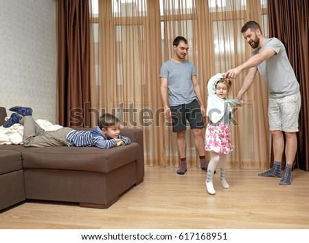 Male gay couple with children having fun at home #617168951