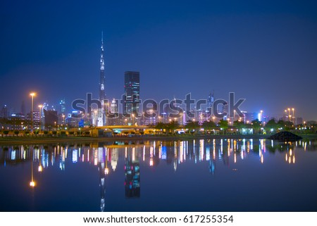 Dubai Skyline at sunset time during spring season 07, April, 2017 with amazing light and new growth for the expo 2020 #617255354