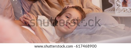Pretty teenage girl going to sleep on her mother's knees #617468900