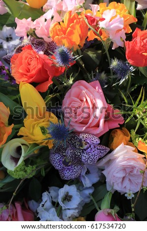 Mixed flower arrangement: various flowers in different colors for a wedding #617534720