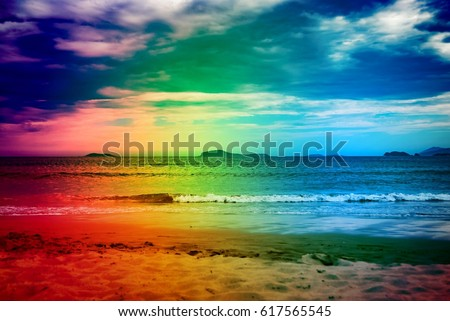 Blue hour in Brazil on the beach against twilight sky. Scene of beautiful heaven in tropical paradise with blue sky and white clouds for travel business concept blog. Image with rainbow color filter