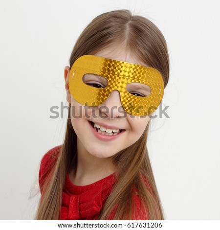 Little girl and mask #617631206