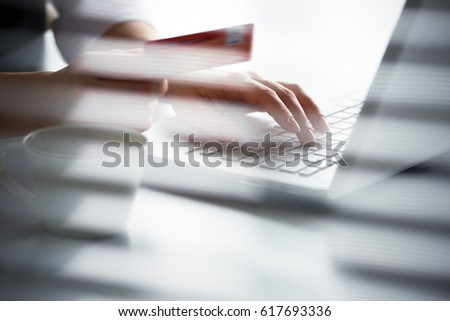 Business woman holding credit card and using laptop. Online payd. #617693336