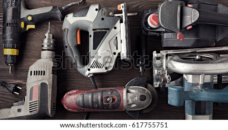 Electric hand tools (screwdriver Drill Saw jigsaw jointer) Royalty-Free Stock Photo #617755751