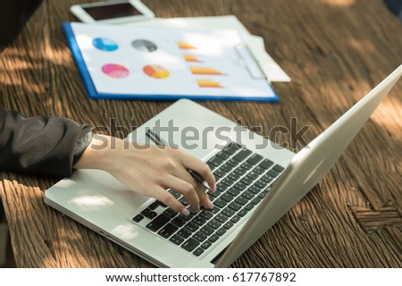Businesswoman working with a notebook computer. #617767892