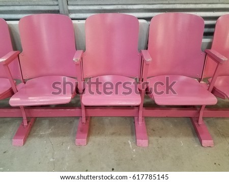row of pink metal chairs #617785145