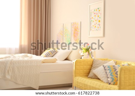 Interior of modern bedroom with cozy bed #617822738