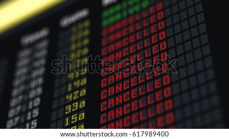 Flights canceled or delayed on information board, terrorism threat at airport  Royalty-Free Stock Photo #617989400