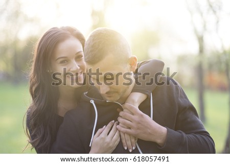 Beautiful young couple in park #618057491