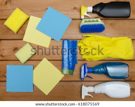 Set of variety cleaning supplies on wooden table #618075569