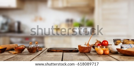 Baking ingredients placed on wooden table, ready for cooking. Copyspace for text. Concept of food preparation, kitchen on background. Royalty-Free Stock Photo #618089717