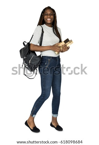 African girl student smiling and holding textbook #618098684