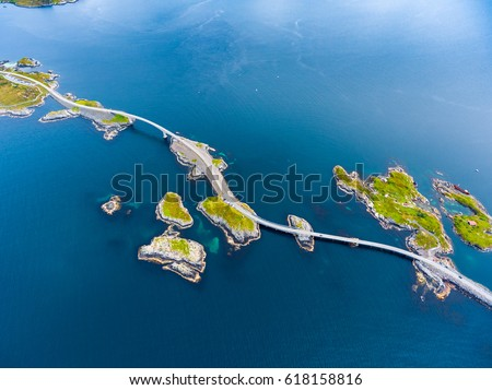 "Atlantic Ocean Road or the Atlantic Road (Atlanterhavsveien) been awarded the title as ""Norwegian Construction of the Century"". The road classified as a National Tourist Route. Aerial photography Royalty-Free Stock Photo #618158816"