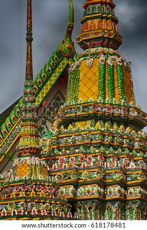 tile pattern on stupa and roof of Buddhist temple in Bangkok Thailand #618178481