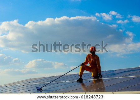 Engineers cleaning  the  solar power panel.  #618248723