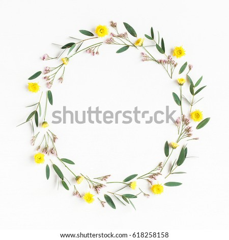 Flowers composition. Wreath made of yellow flowers and eucalyptus leaves on white background. Flat lay, top view #618258158