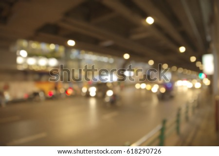 Abstract blurry car traveling in the night in central Bangkok area #618290726