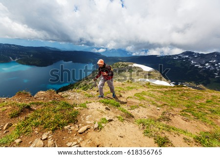 Hiking man in Canadian mountains. Hike is the popular recreation activity in North America. There are a lot of picturesque trails. #618356765
