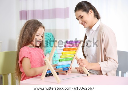 Young woman teacher and little girl on private lesson #618362567