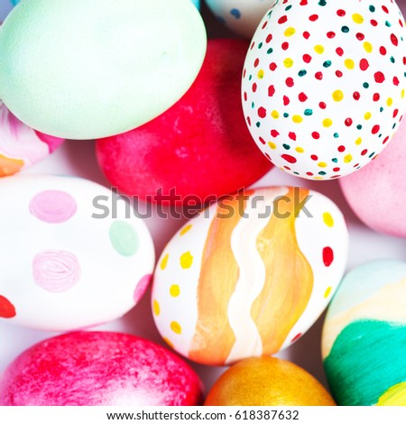 Colorful Easter Eggs on white with copy space. #618387632