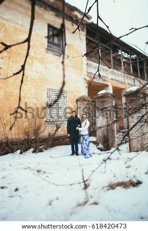 Winter wedding. Beautiful young couple in the old #618420473
