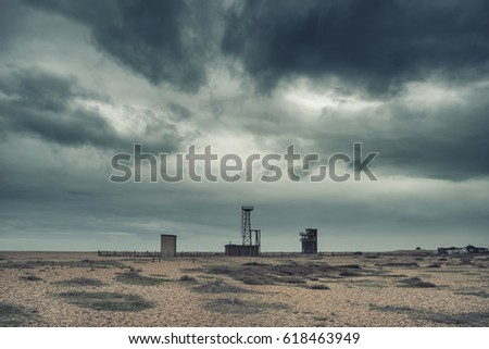Cross processed conceptual post apocalyptic nuclear landscape with abandoned buildings Royalty-Free Stock Photo #618463949