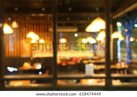 Abstract blur of restaurant with blurred light bokeh background #618474449