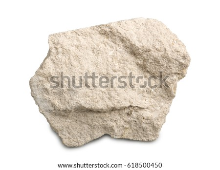 Limestone isolated on white background. Limestone is a sedimentary rock  composed of skeletal fragments of marine organisms. Royalty-Free Stock Photo #618500450