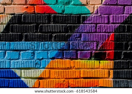 Graffity wall. Abstract detal of Urban street art design close-up. Modern iconic urban culture, stylish pattern. Can be useful for backgrounds. Aerosol pictures