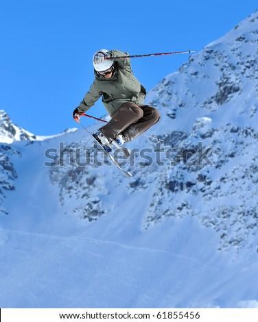 Ski Jumper performing  a tail grab #61855456