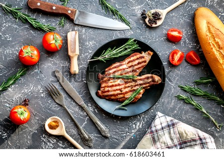 meat for steak with rosemary and tomato on table top view #618603461