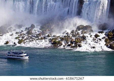 Beautiful background with amazing Niagara waterfall US side and a ship
