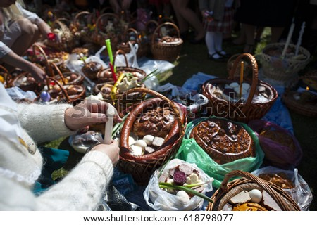 Traditional easter holidays in West Ukraine near church with baskets of paska and egg #618798077